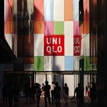 People stand outside a UNIQLO shop in Beijing