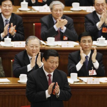 Xi claps after he was elected China's Vice President during a plenary session of China's parliament in Beijing