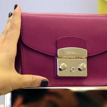 "A shop assistant arranges a ""Metropolis"" bag in the Furla flagship downtown Milan"