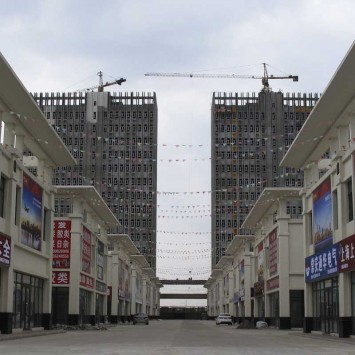 Buildings under construction are seen behind The International Hardware and Building Materials City two weeks after the city's ground opening ceremony in Qiqihar