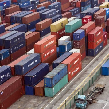 Containers are seen at a port of Shanghai Free Trade Zone