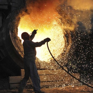 An employee works at the Maanshan steel and iron factory in Hefei