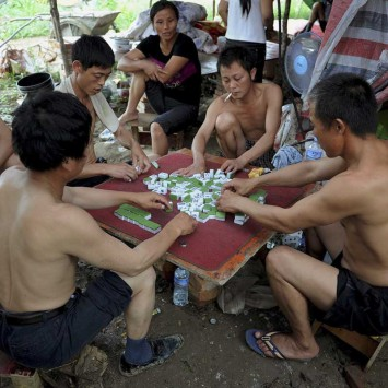 mahjong men migrant workers