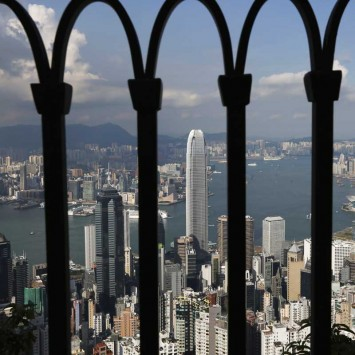 Skyline of Hong Kong is seen through a fence at the Peak in Hong Kong