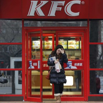 A woman walks out a KFC restaurant in Beijing
