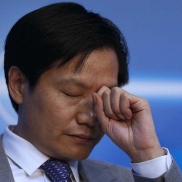 Lei Jun, founder and chief executive officer of Xiaomi, reacts during a session of the second annual World Internet Conference in Wuzhen town