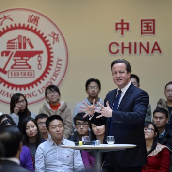 British Prime Minister David Cameron gestures as he delivers a speech to students during his trip in China at Shanghai Jiao Tong University in Shanghai