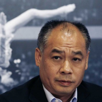Li Ning, founder of Li Ning sportswear retail company, attends a news conference to announce Viva China in Hong Kong