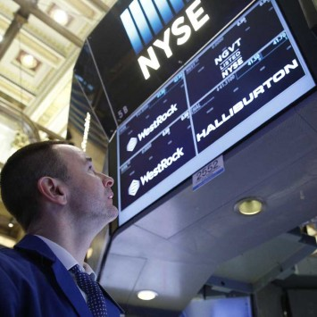 A specialist trader works at the post where Halliburton is traded on the floor of the NYSE
