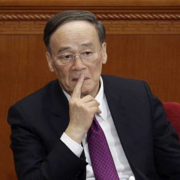 Wang Qishan, China's Politburo Standing Committee member and head of China's anti-corruption watchdog, attends the opening session of the CPPCC in Beijing