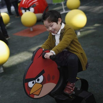 A child plays on an Angry Bird rocker at a real life Angry Bird's outdoor game in a theme park in Shanghai