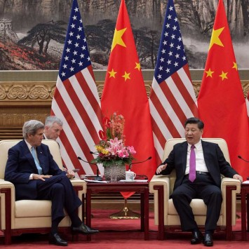 China's President Xi Jinping speaks with U.S. Secretary of State John Kerry at the Great Hall of the People during the end of the 8th round of U.S.-China Strategic and Economic Dialogues in Beijing