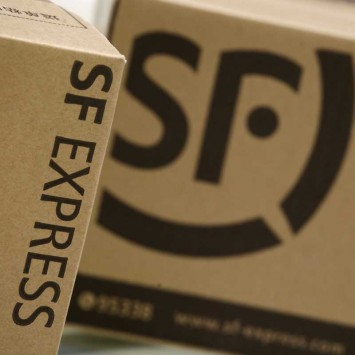 SF Express courier boxes are displayed in this illustration photo at the company's headquarters in Shenzhen