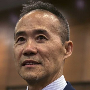 Vanke's Chairman Wang Shi attends the debut of his company at the Hong Kong Stock Exchange