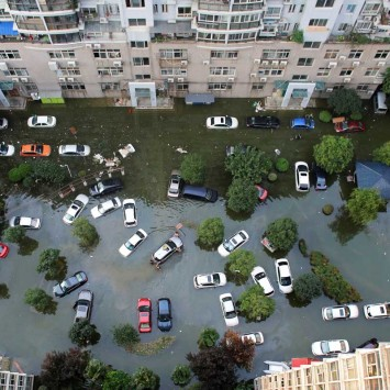 Automobiles are seen flooded at a neighbourhood in Wuhan