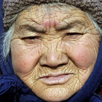 A 73-year-old local woman pauses as she prays for good fortune outside Dafo Temple on the Lantern Festival in Zhengding County