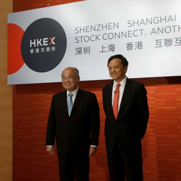 Charles Li and Chow Chung-kong attend a news conference in Hong Kong