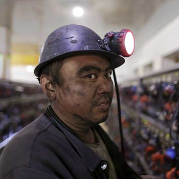 A miner is pictured before he takes his  self rescue equipment off at a coal mine of the state-owned Longmay Group on the outskirts of Jixi in China