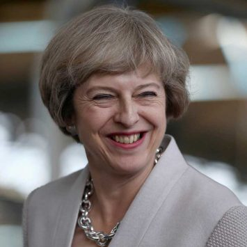 Britain's Prime Minister Theresa May visits a joinery factory in London