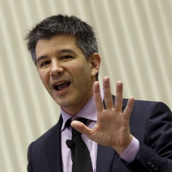 Uber CEO Travis Kalanick addresses a gathering during a conference of start-up businesses in New Delhi