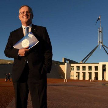 Australian Federal Treasurer Scott Morrison stands outside Australia's Parliament House in Canberra May 4, 2016 following the announcement  Australia's 2016-17 Federal Budget