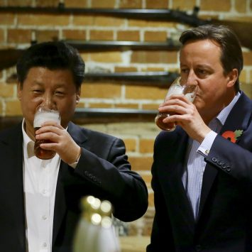 Britain's Prime Minister David Cameron drinks beer with Chinese President Xi Jinping at a pub in Princess Risborough, near Chequers