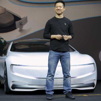 "Jia Yueting, co-founder and head of Le Holdings Co Ltd, also known as LeEco and formerly as LeTV, unveils an all-electric battery ""concept"" car called LeSEE during a ceremony in Beijing"