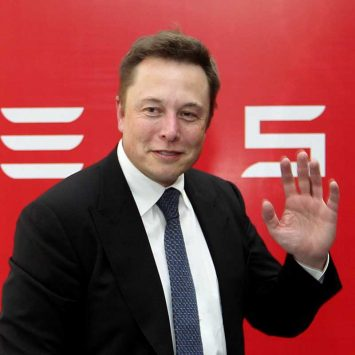 CEO of Tesla Motors Musk waves during a news conference in Beijing