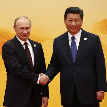 Russia's President Putin shakes hands with China's President Jinping during a welcoming ceremony at the APEC summit in Beijing