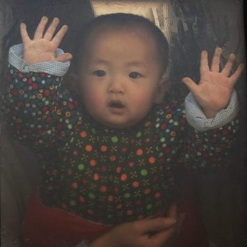 A baby looks through the window of a vehicle stranded on a highway between Beijing and Hebei province, China, that is closed due to smog on an extremely polluted day